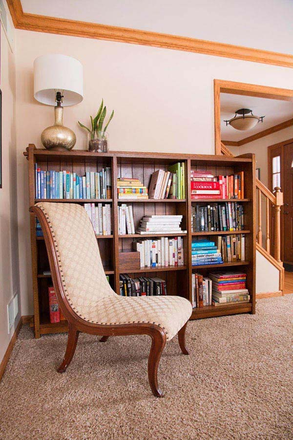 slipper chair in front of large mission stickley bookcase