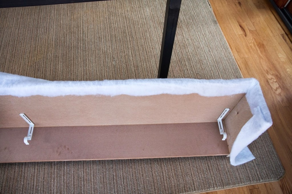 cornice box wrapped with batting on floor