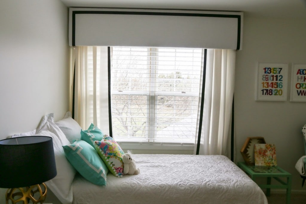 diy valance box with white curtains and black ribbon with bed in front of window