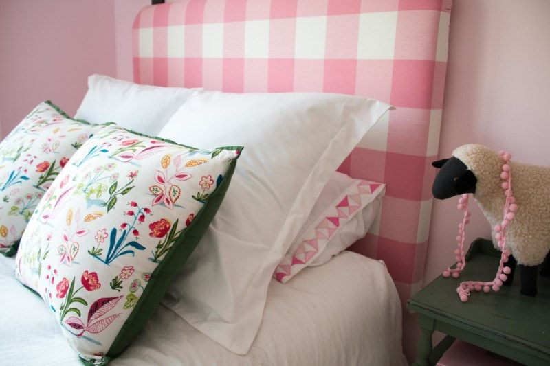 DIY Upholstered Headboard made out of pink buffalo check fabric