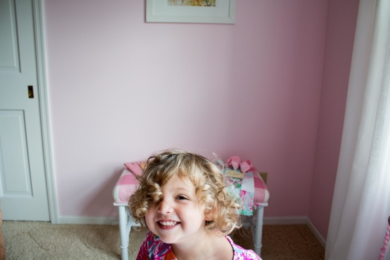little girl with diy upholstered bench--see how to upholster a bench with this tutorial by DIY Decor Mom