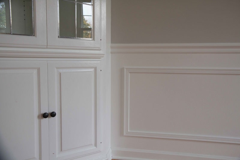 The Dining Room Before and After DIY Paneling & Paint - How to Paint Cabinets Like a Pro by popular home decor blogger DIY Decor Mom