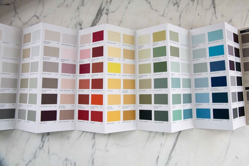 paint chips on marble background- how to pick out paint colors