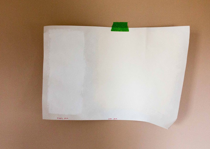 paint samples taped on wall- how to pick out paint colors