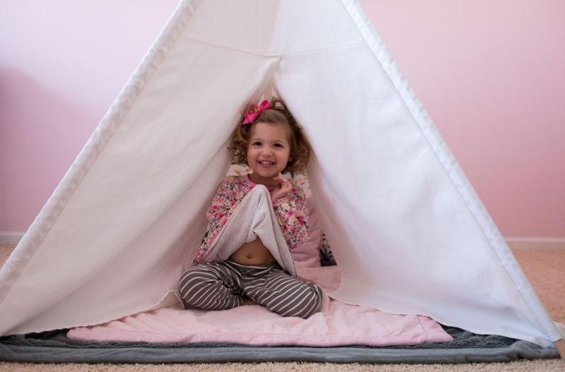 girl in a teepee