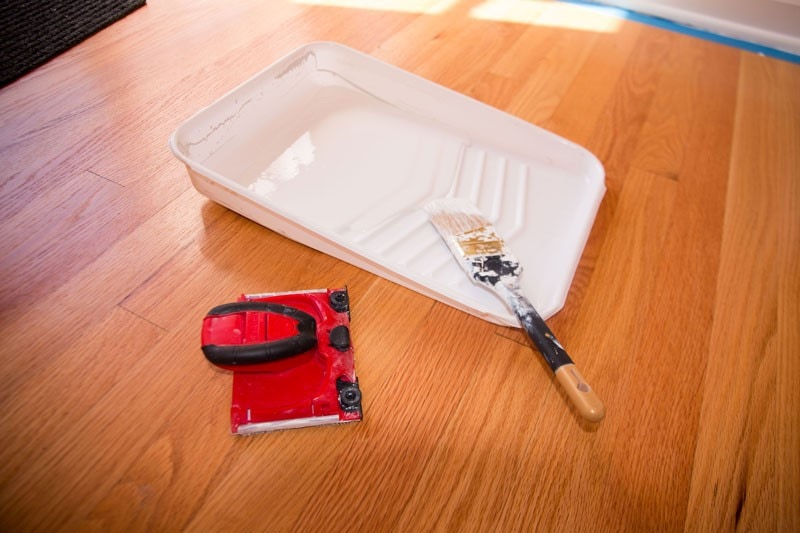 paint wood trim supplies with a paint tray paint brush and paint edger