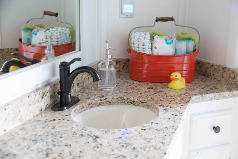 granite counter white painted bathroom cabinets