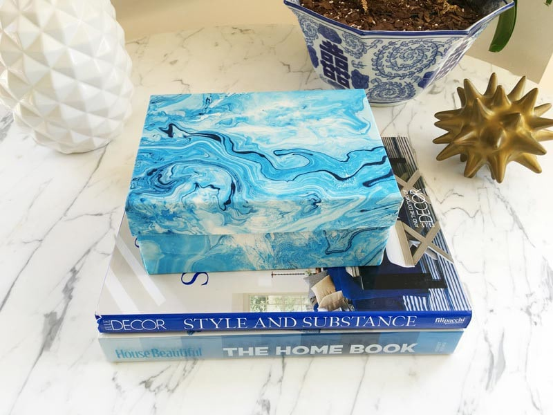 blue marble decorative box on top of a stack of books