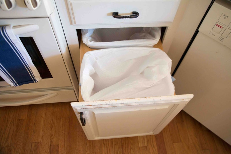 clean garbage cans- part of spring cleaning checklist