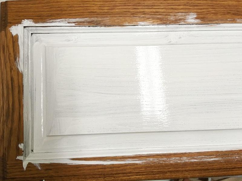 wood oak bathroom cabinet with one coat of Smart Prime primer
