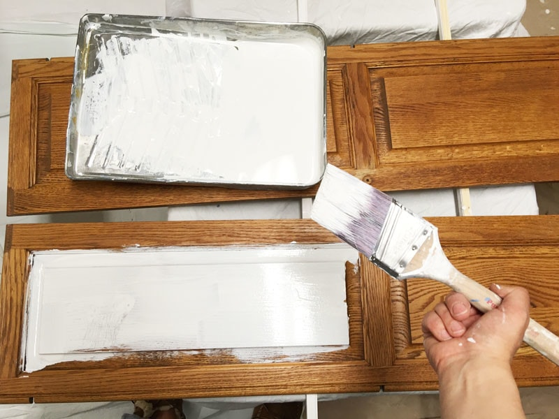 wood cabinets and white paint with primer