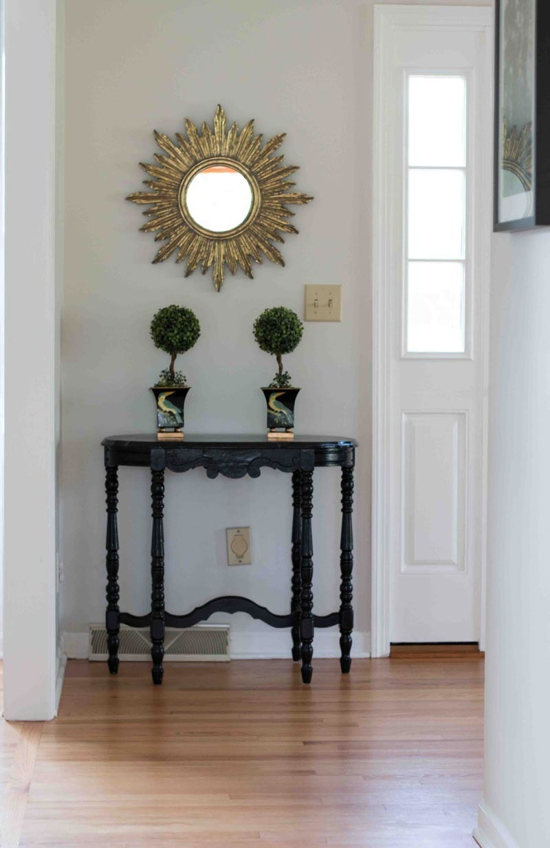 BM classic gray paint color on walls in foyer hallway with black table and Simply White trim