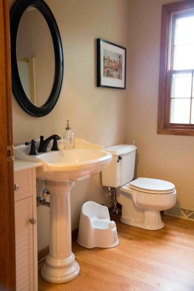 brown bathroom with wood trim before and after