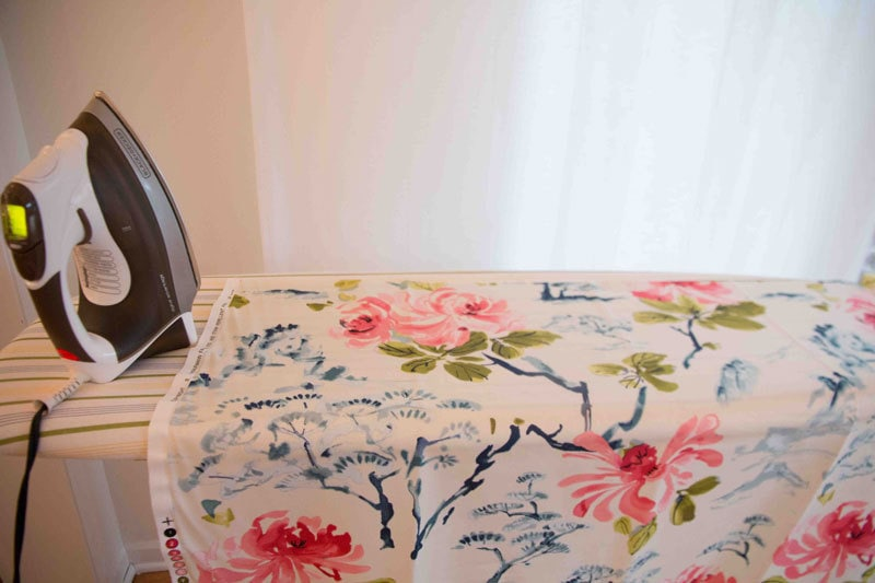 ironing fabric for DIY Roman Shades tutorial