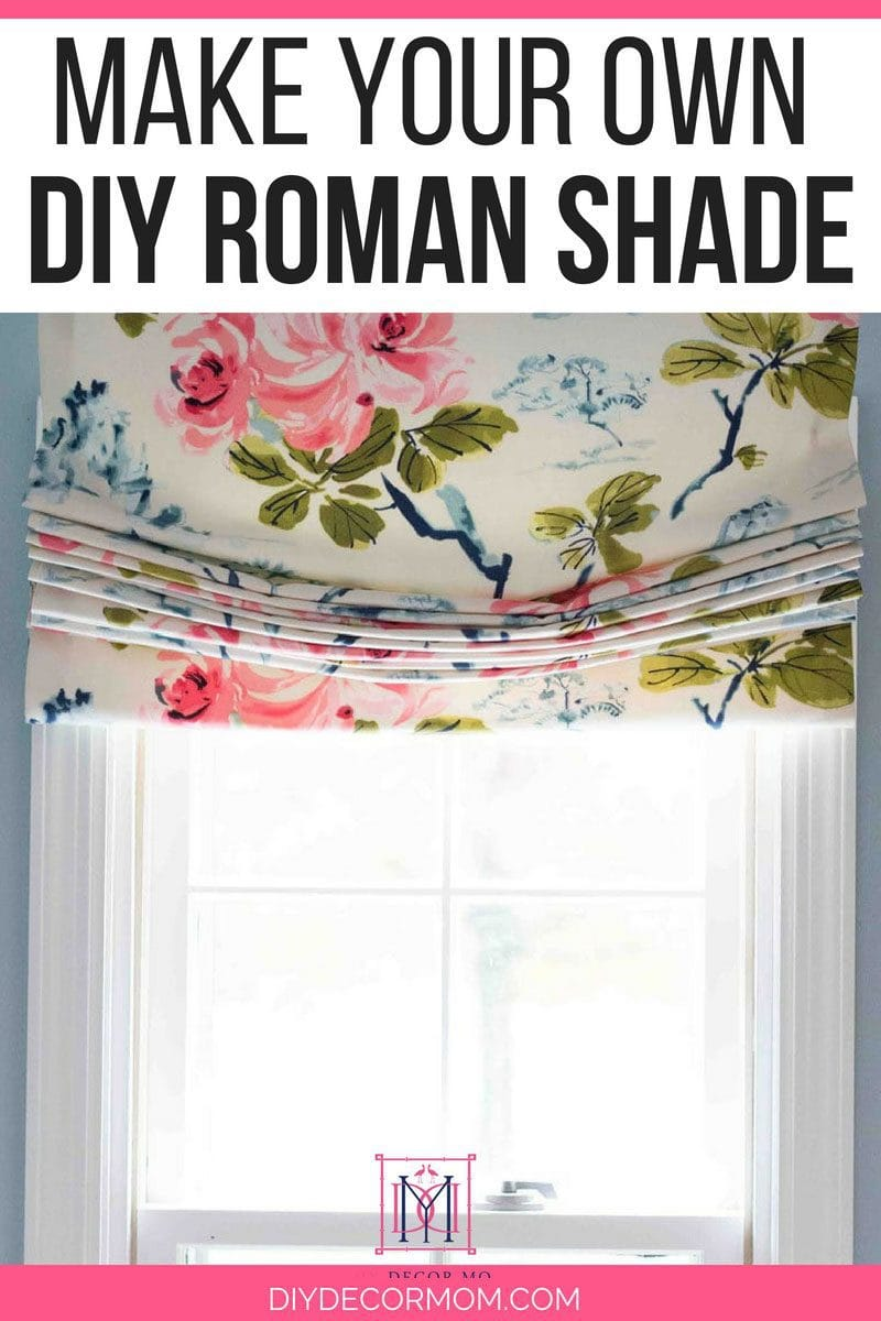 diy roman shade tutorial of relaxed roman shade with flowery fabric on window in bathroom