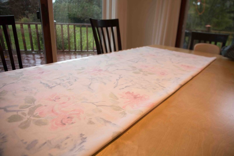 fabric laid out on table for DIY Roman Shades--instructions on how to make roman shades