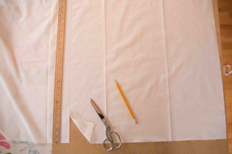 fabric with ruler pencil and fabric shears on table for making roman shades