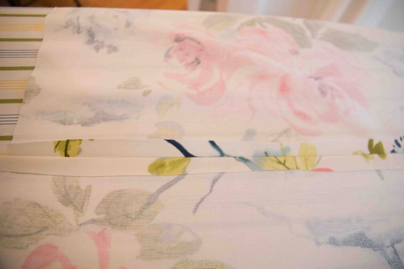 picture of two pieces of flowery fabric sewn together for DIY Roman Shades