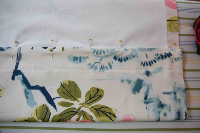 pins holding fabric and liner together in DIY Roman Curtains tutorial