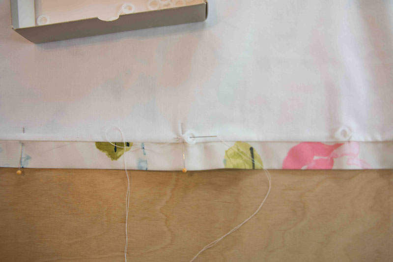 sewing upholstery hooks onto DIY Roman Shade with pins and needles