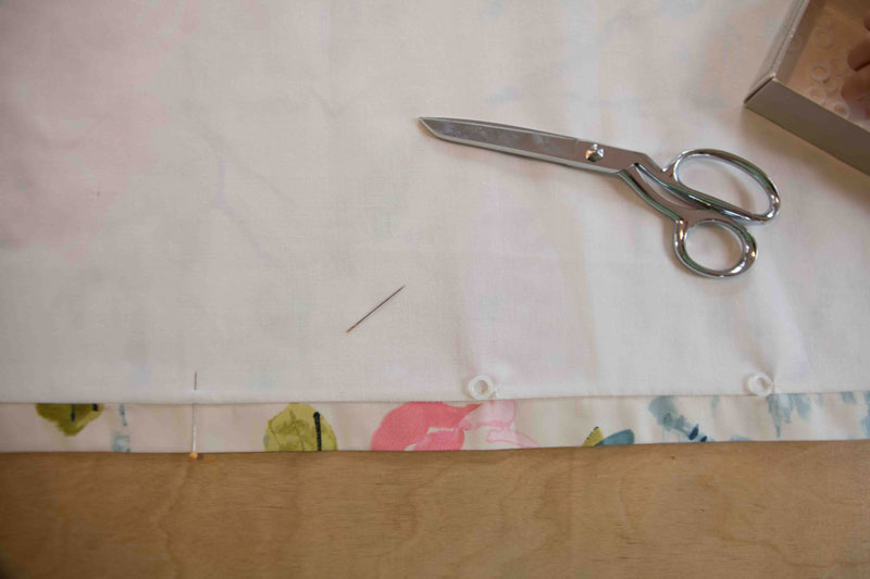 How to Make Roman Shades: picture of fabric with drapery hooks, pins, and fabric shears