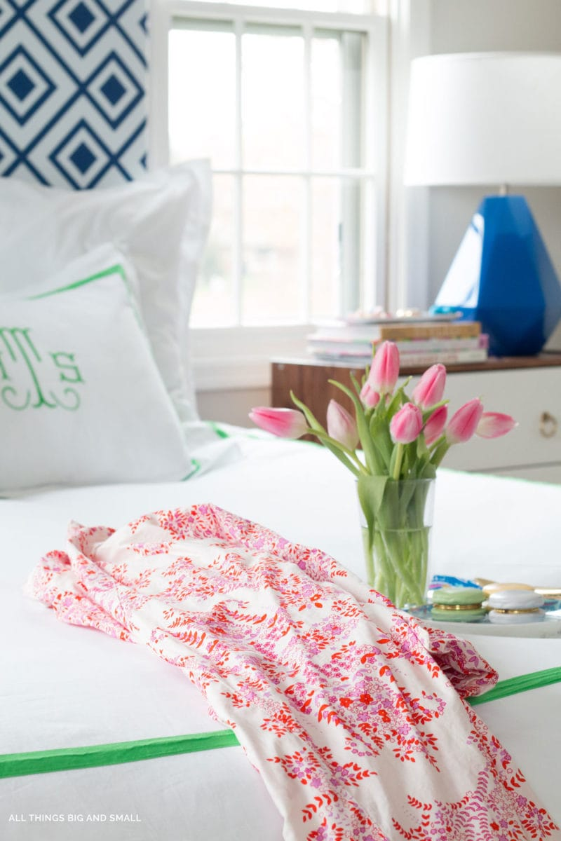 image of bed with flowers and a robe- important first trimester things to do