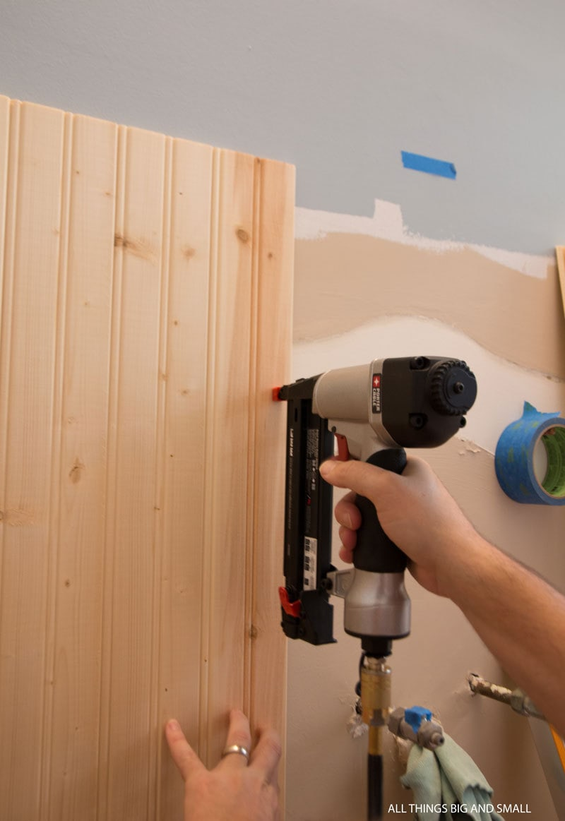 use a nail gun to hold the boards in place while the liquid nails work to adhere to bathroom walls for beadboard bathroom