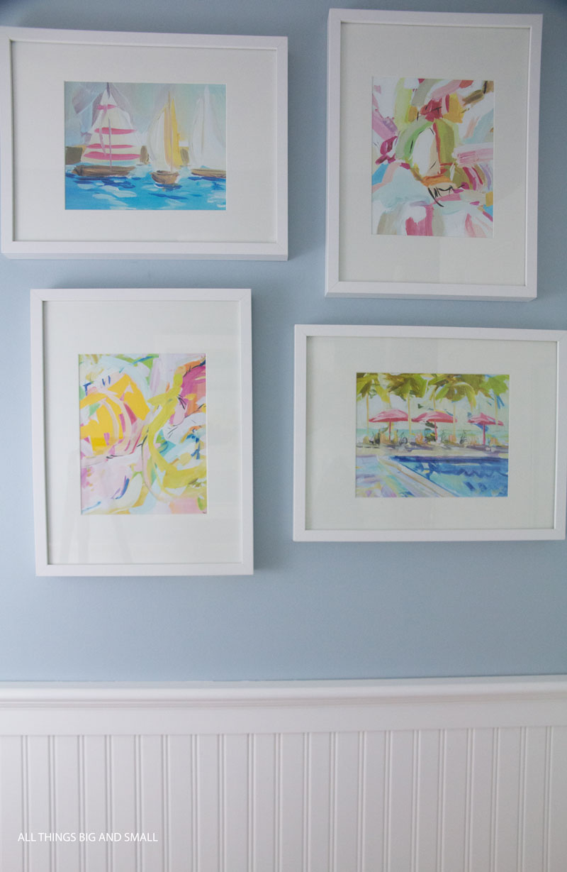 art above beadboard walls in bathroom--see how to install beadboard in this easy tutorial