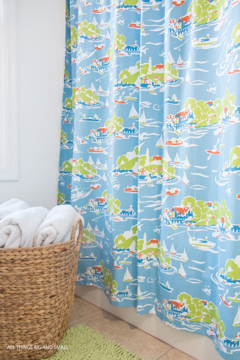 kids bathroom shower curtain nautical theme with woven basket holding towels