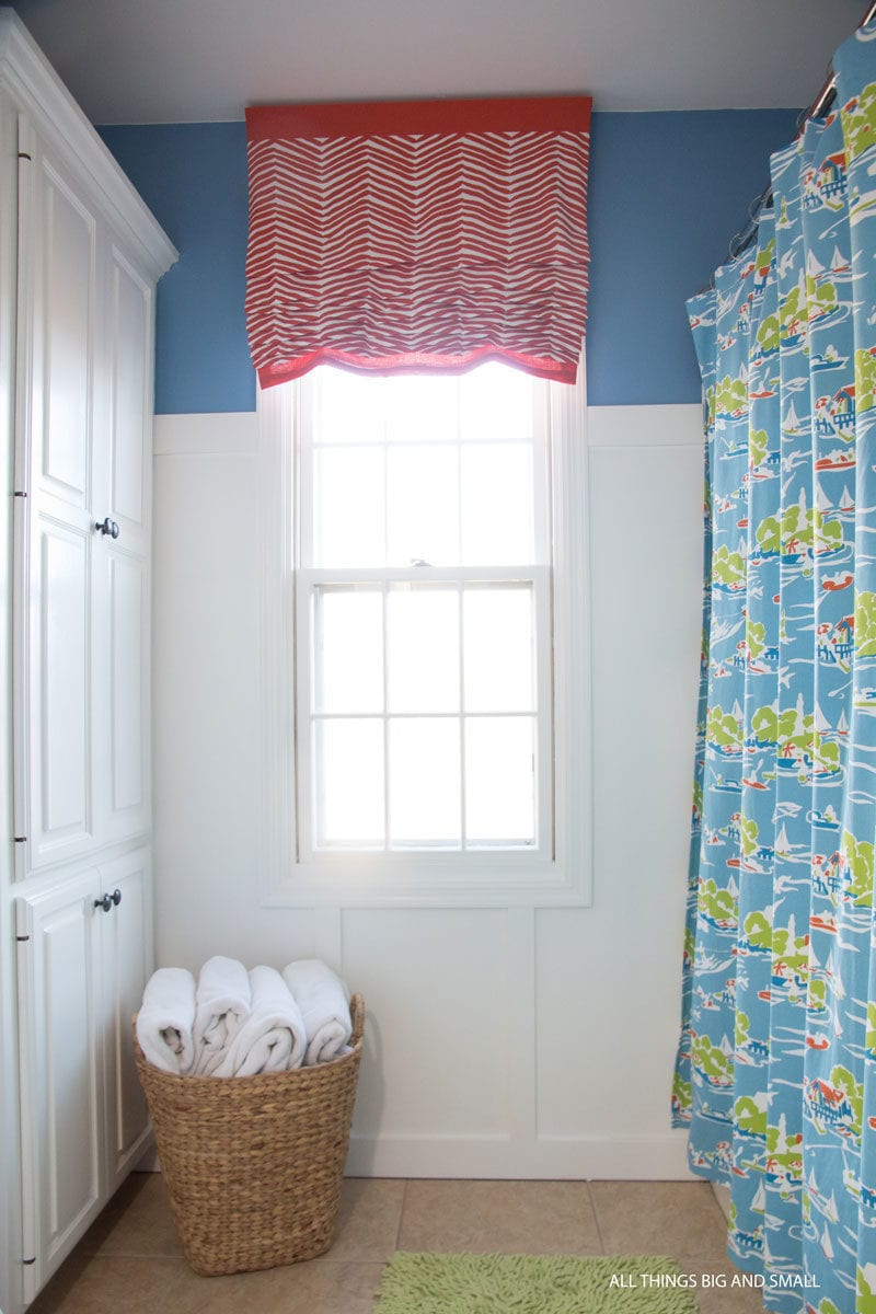 picture of DIY Roman Shades in bathroom with blue walls board and batten paneling for tutorial on how to make roman shades