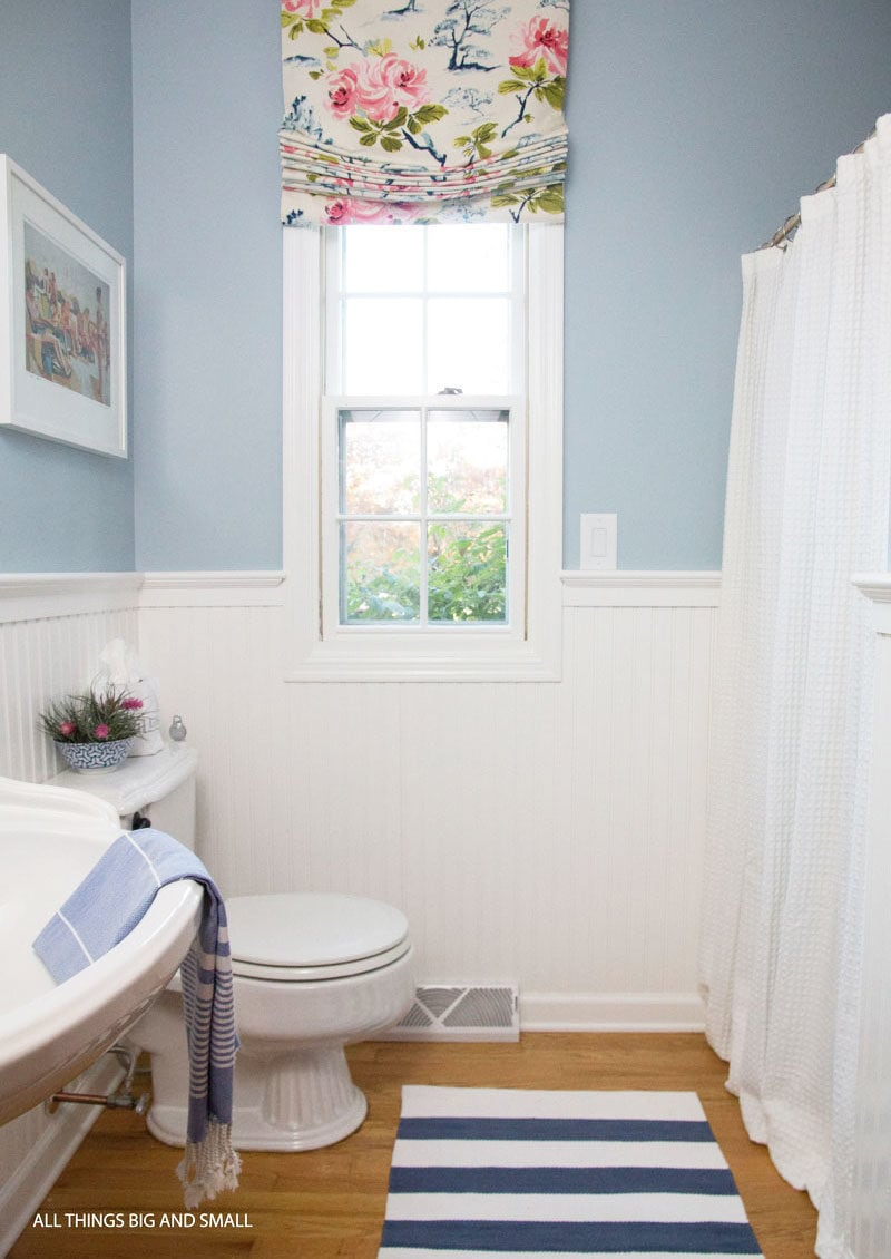 blue and white bathroom with colorful patterns showing how to mix and match fabrics