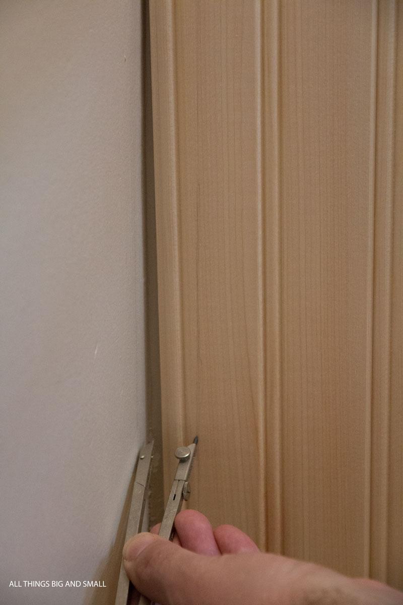 wall gap between beadboard planks and walls in bathroom