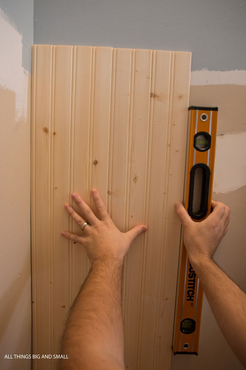 installing beadboard walls in bathroom with level