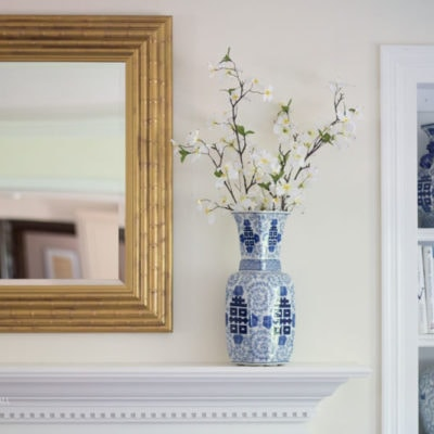 You will love this DIY Gold Mirror Frame- such an easy way to change your wall mirror!