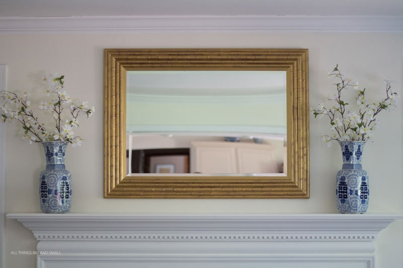 This wall mirror makeover looks soooo good! Love the gold frame mirror now!