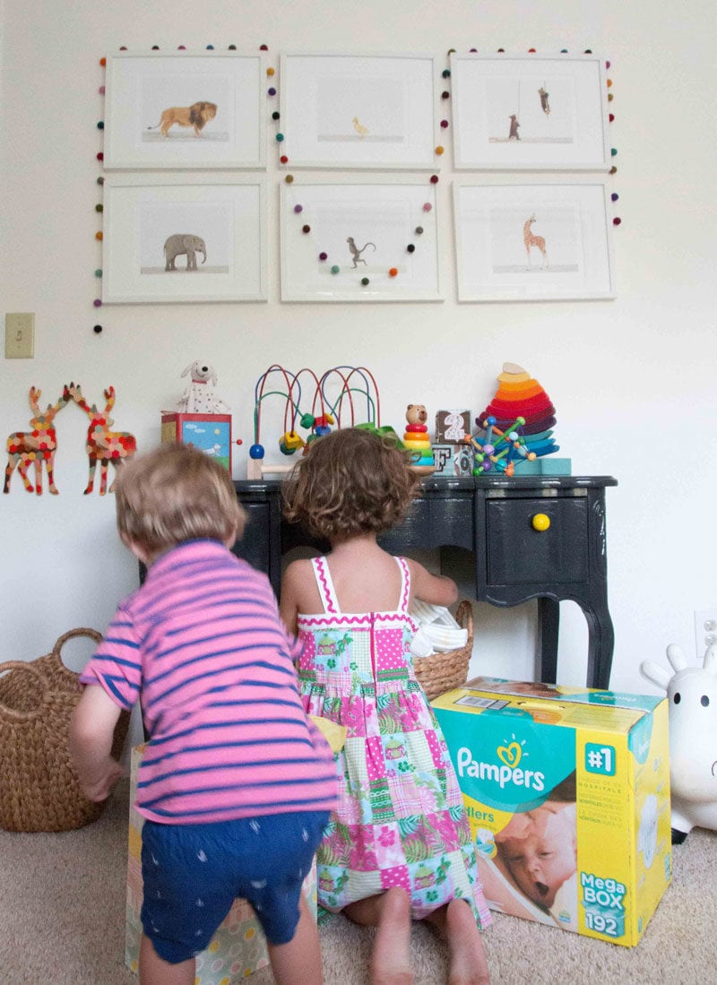 big brother and big sister prepare for new sibling and set up nursery