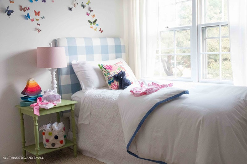 The cutest blue buffalo check DIY headboard! Such a cute nursery!