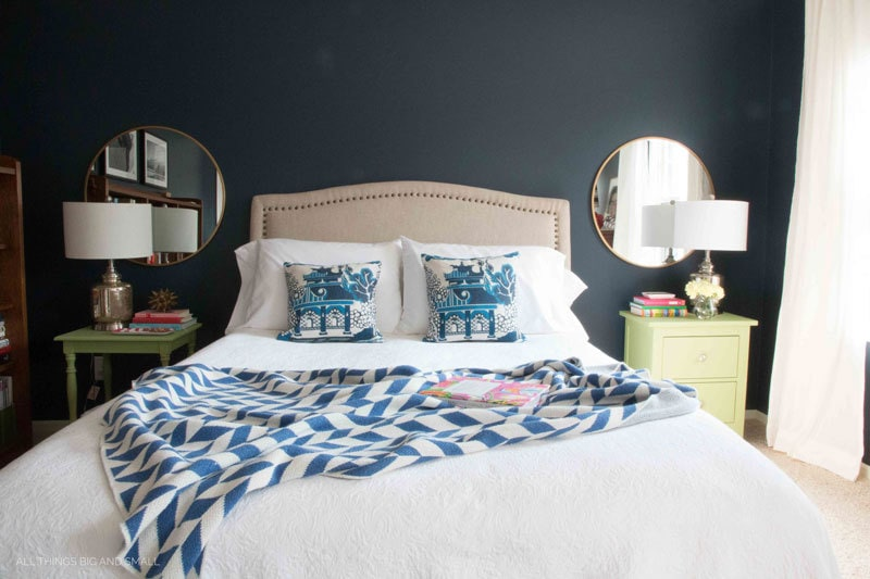 navy blue bedroom with hale navy walls and blue and white bedding