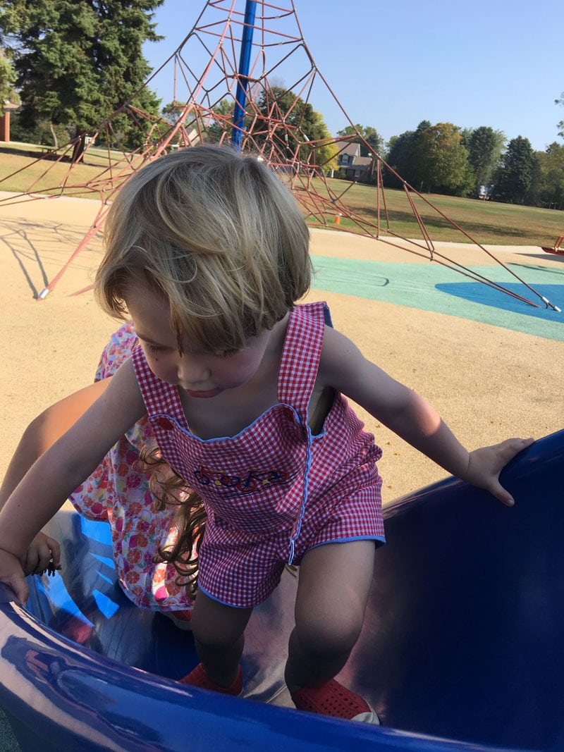 toddler climbing slide at park- summer schedules for kids that work