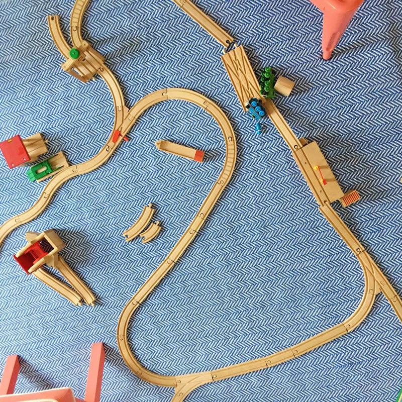 train tracks on playroom floor rug