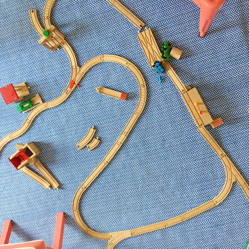 train tracks on playroom floor rug