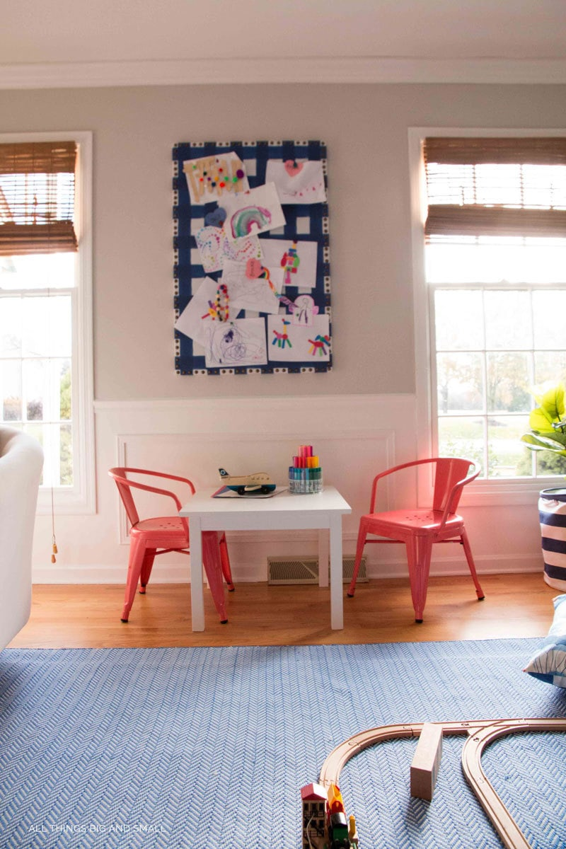 LOVE the playroom decor--kids table and bulletin board with playroom art