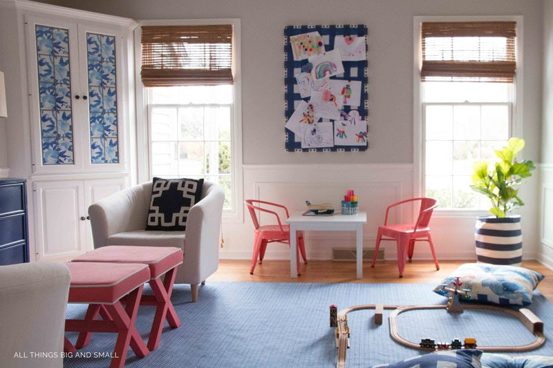 fabric bulletin board in playroom with childrens art
