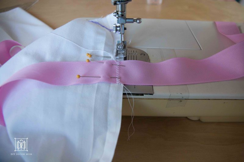 sewing DIY crib skirt with ribbons