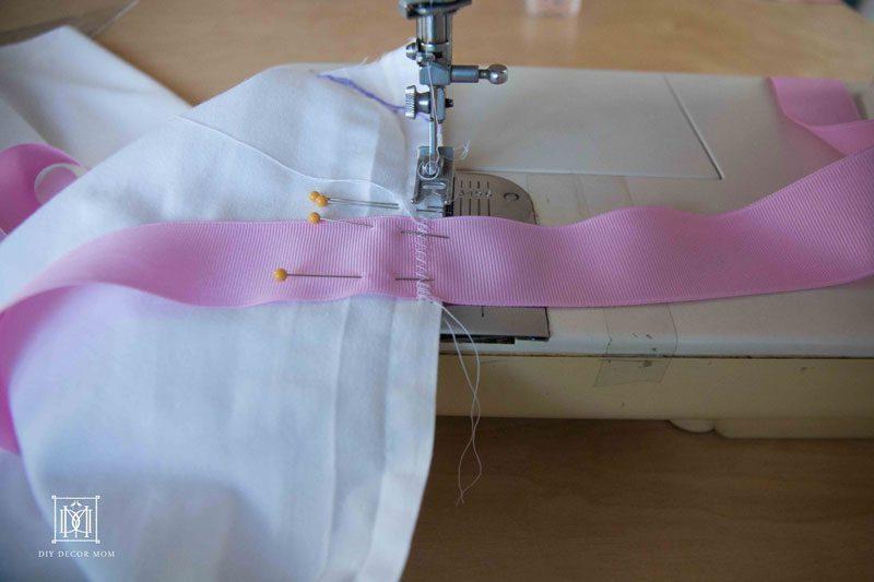 sewing DIY crib skirt with ribbons