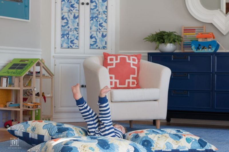 kid bouncing on diy floor pillow and giant floor cushions