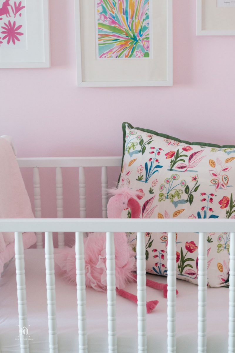crib is a newborn must have- this darling baby girl nursery is full of must have baby essentials for new moms