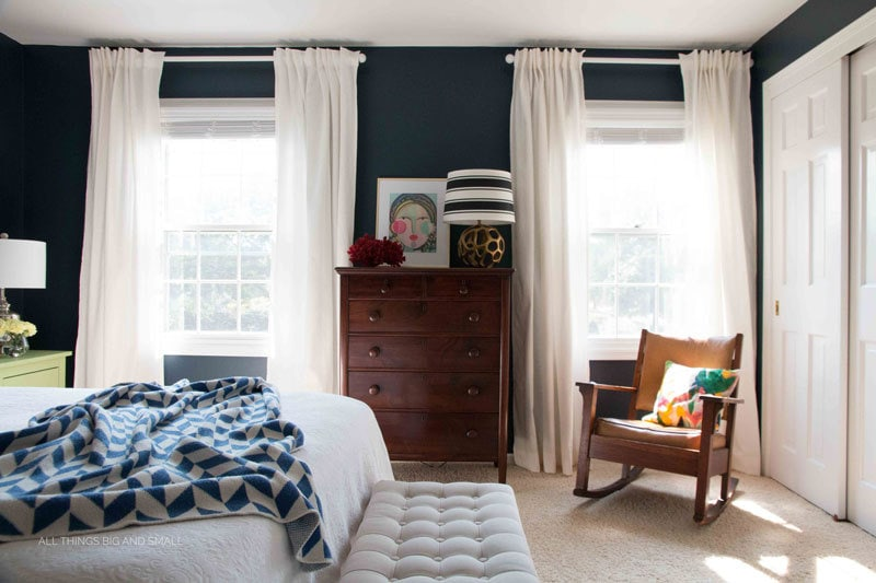 blue and white bedroom with navy blue walls