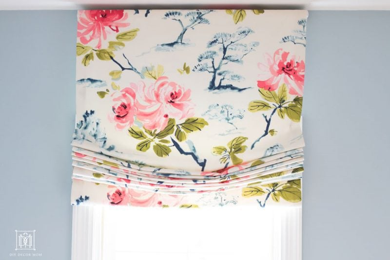 pink blue and white chinoiserie roman shade fabric in blue and white bathroom