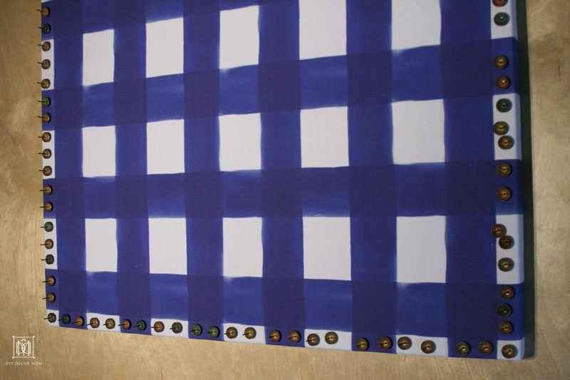 fabric covered bulletin board with nailhead trim